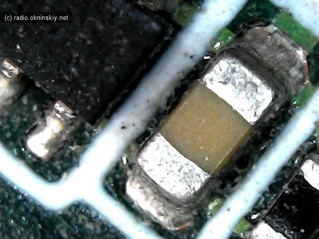 фото смд конденцатора в микроскопе USB с али